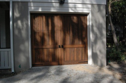 A Garage Door With Ring Handles And Hinge Fronts
