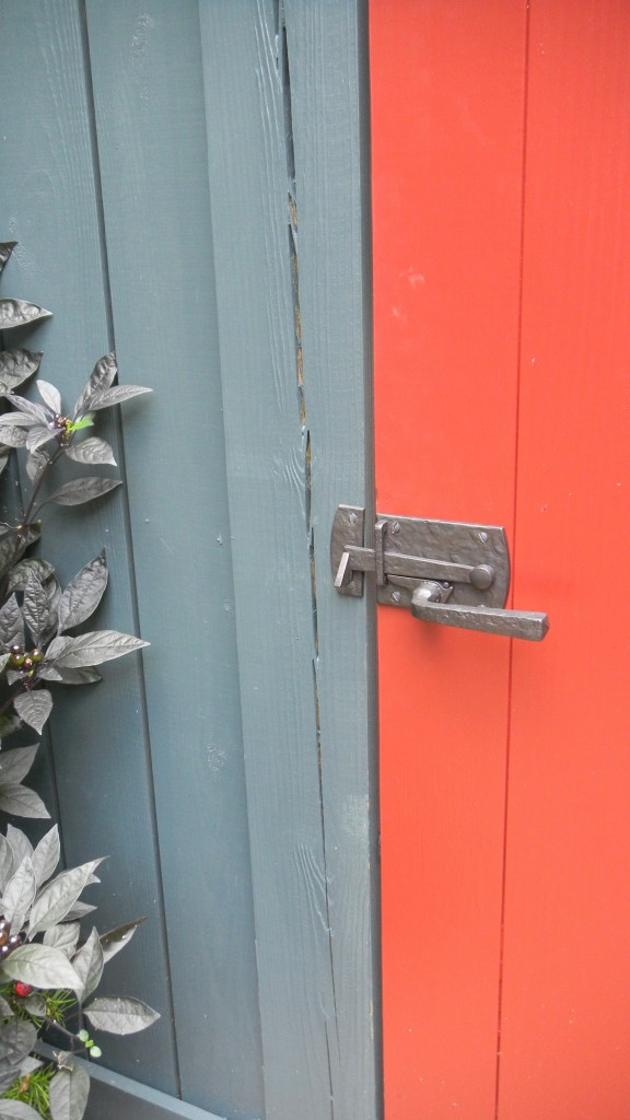 Close-Up View of the Latch from the Interior Patio Side. I love how the latch spans two colors!