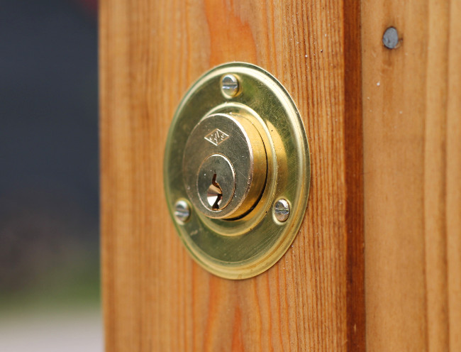 Exterior View of Brass Cylinder on Keyed Gate Lock and Latch