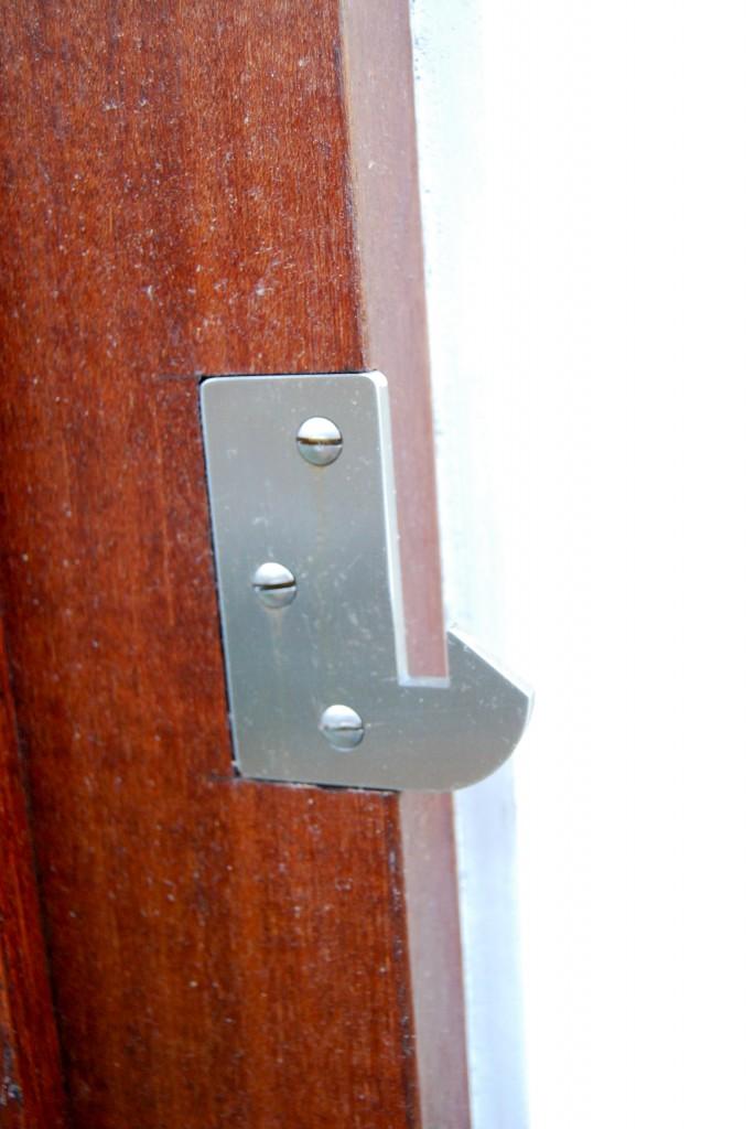 Marine grade stainless steel strike plate for modern gate latch