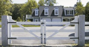 Driveway entry gates with black traditional strap hinges