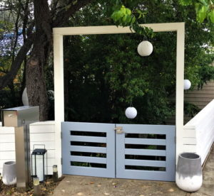 Double outswinging gate with a stainless steel Alta lever gate latch