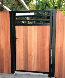 A modern metal gate with modern black gate latch
